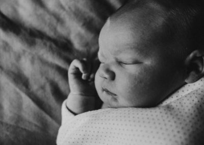 Newborn baby laying on bed, In home newborn session, Jo Ellen Pictures