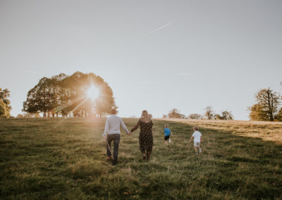 Family walking through fields at Knole Park