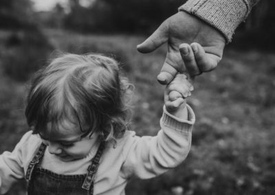 Daughter holding father hand, family photoshoot