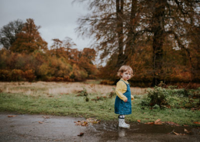 Little Girl jumping jumping in puddle