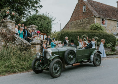 Bride and Groom leaving Brightling Church