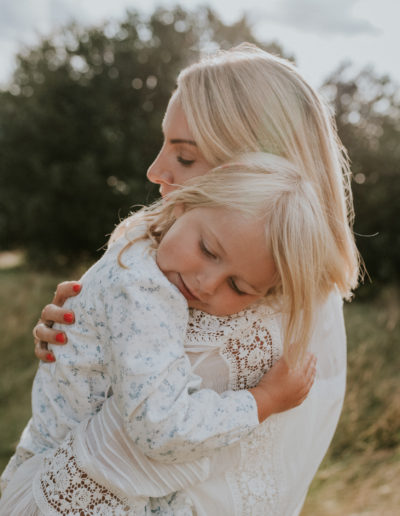 Mother cuddling Daughter, family photoshoot