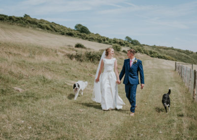 couple walking on The Downs, wedding day