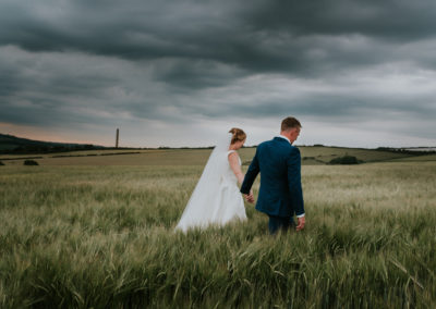 Couple portraits in barley fields