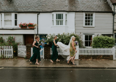 Bride walking through Lewes, wedding day