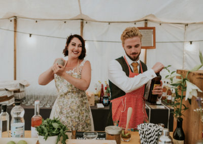Couple making cocktails on wedding day