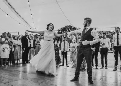 couple on dance floor, wedding day, first dance