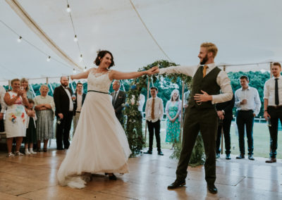 Couple on dance floor, wedding day