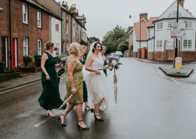 Bridal party crossing road in Lewes
