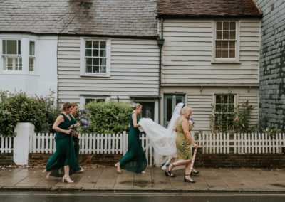Bridal party walking through Lewes