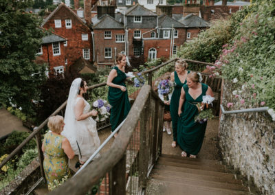 Bridal party walking up steps at Lewes Castle