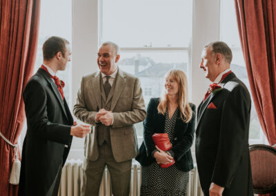 wedding guest laughing at window of register office
