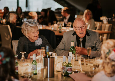 Grandparents laughing at wedding reception