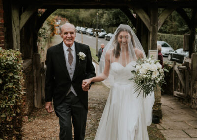 Bride and her father approaching Limpsfield church