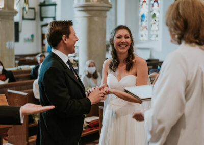 Bride and Groom laughing whilst getting married in Limpsfield Church