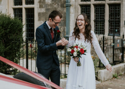 Bride and Groom laughing outside registry office after getting married